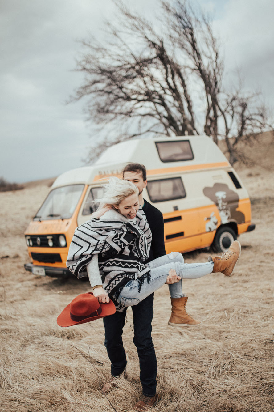 Two van travellers exploring and enjoying nature and discovering love